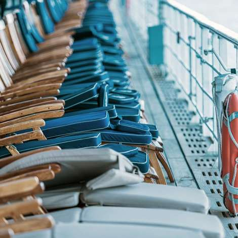 Cruise Ship Oceanliner Travel Risk and Crisis Management. Empty Deckchairs on Main Deck of the Vessel.
